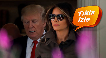 Melania Trump eşiyle birlikte gazetecilere poz vermeyi reddetti